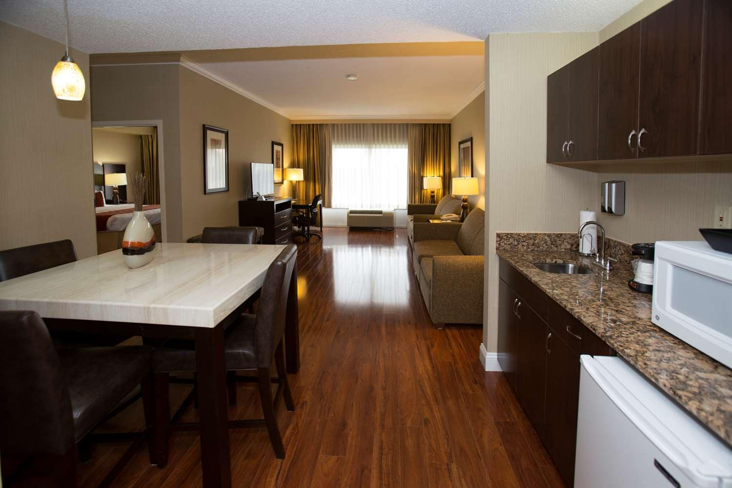 Living Area Of Two Room Suite. Having A Gathering With Loved Ones, This  Suite Is Perfect!