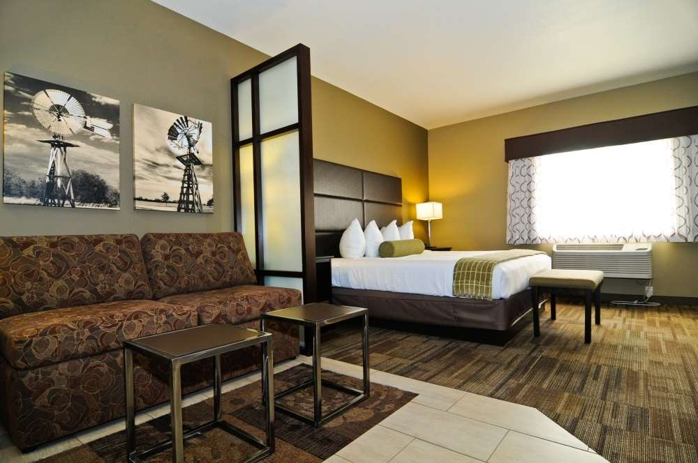 Stay In One Of Our King Suites With A Sleeping Area As Well Comfortable Seating