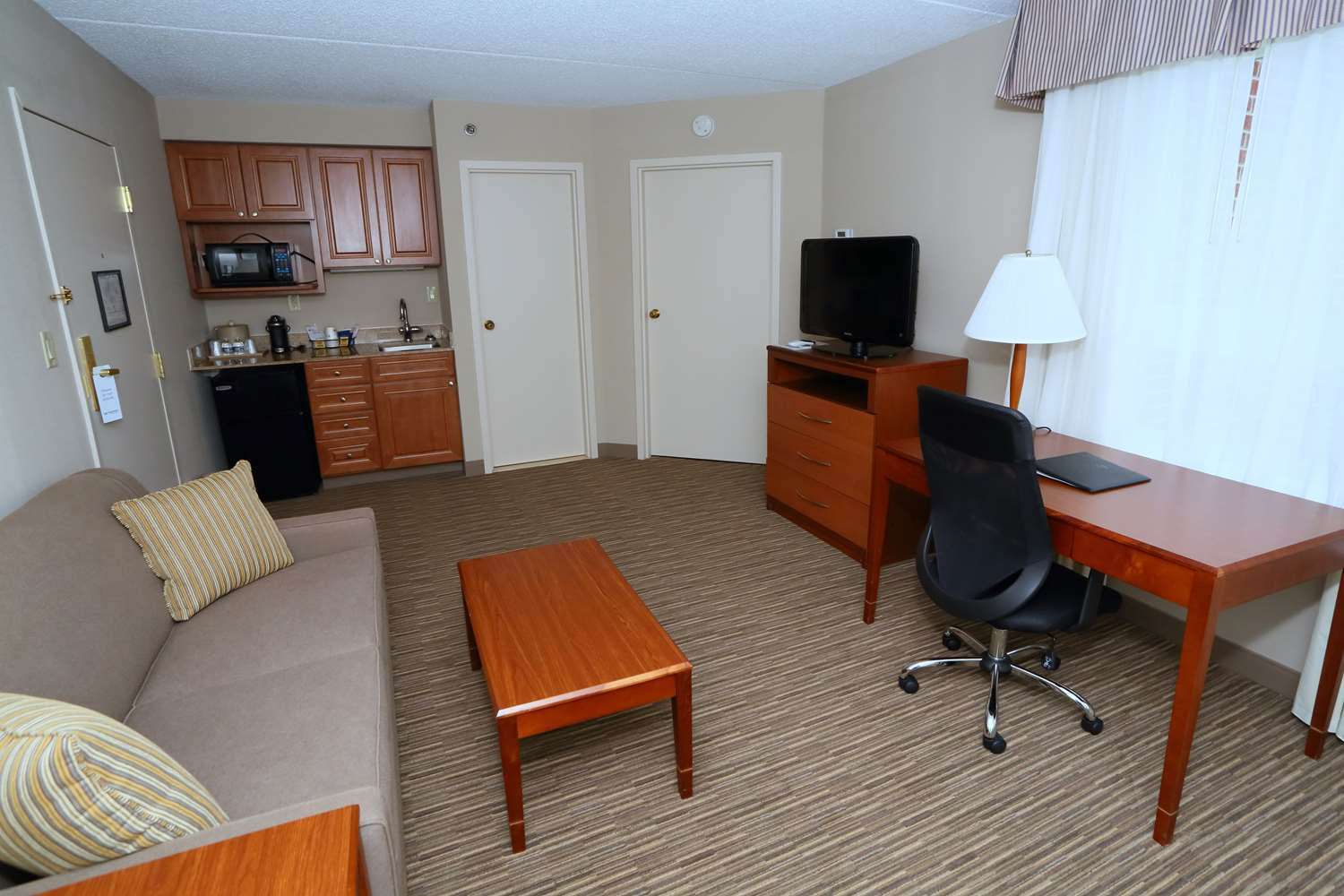 Our Suites Offer An Living Room With Work Desk Sleeper Sofa And Television