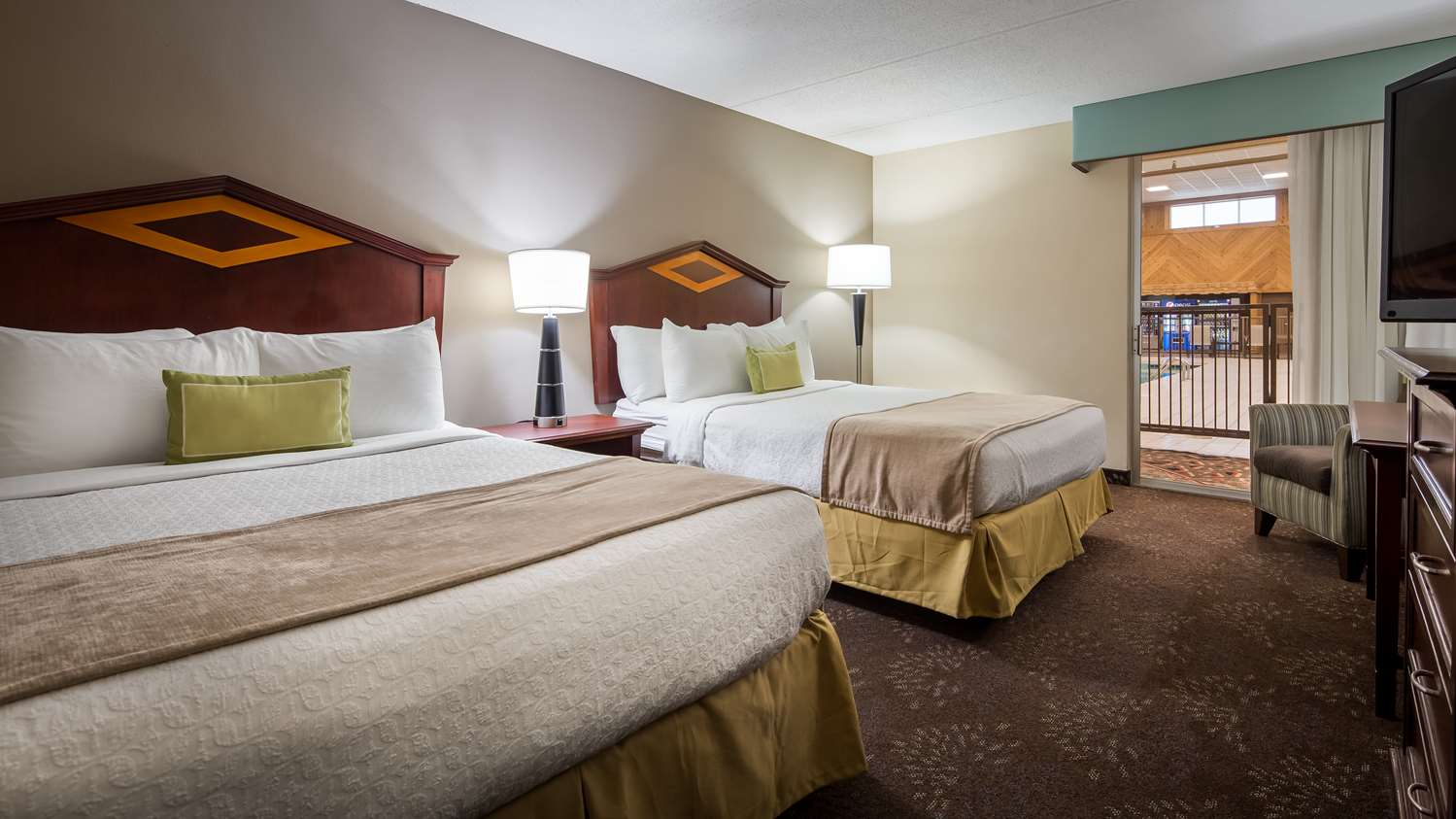 Relax Poolside In Our Two Queen Guest Room