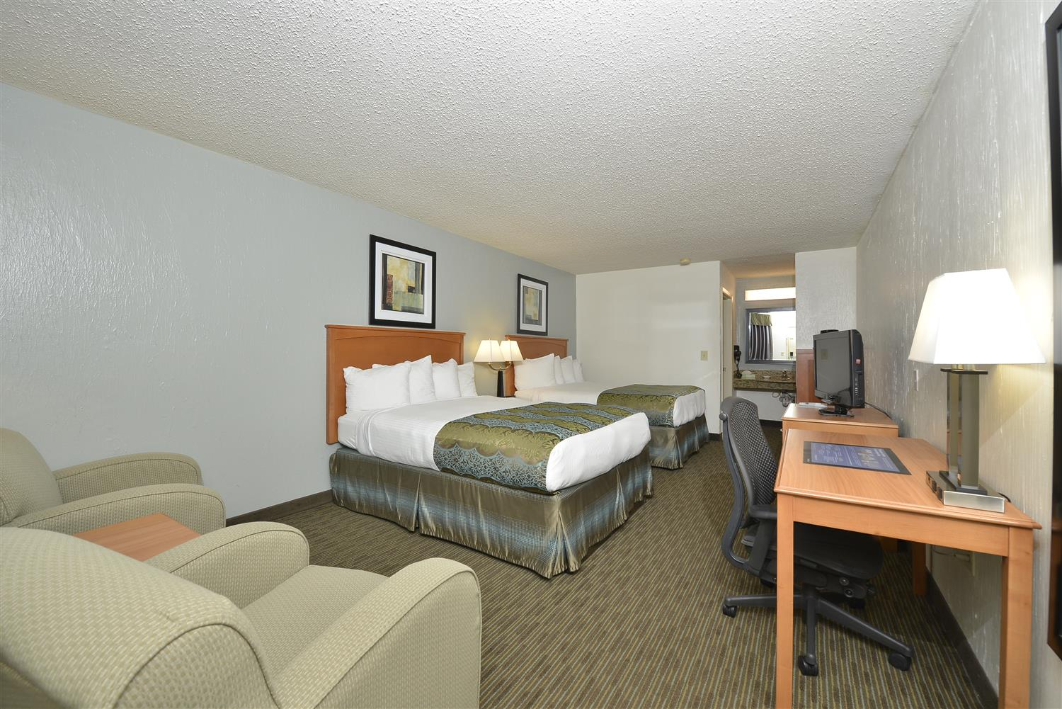 Our Comfortable Two Queen Guest Room Includes Microwave And Refrigerator