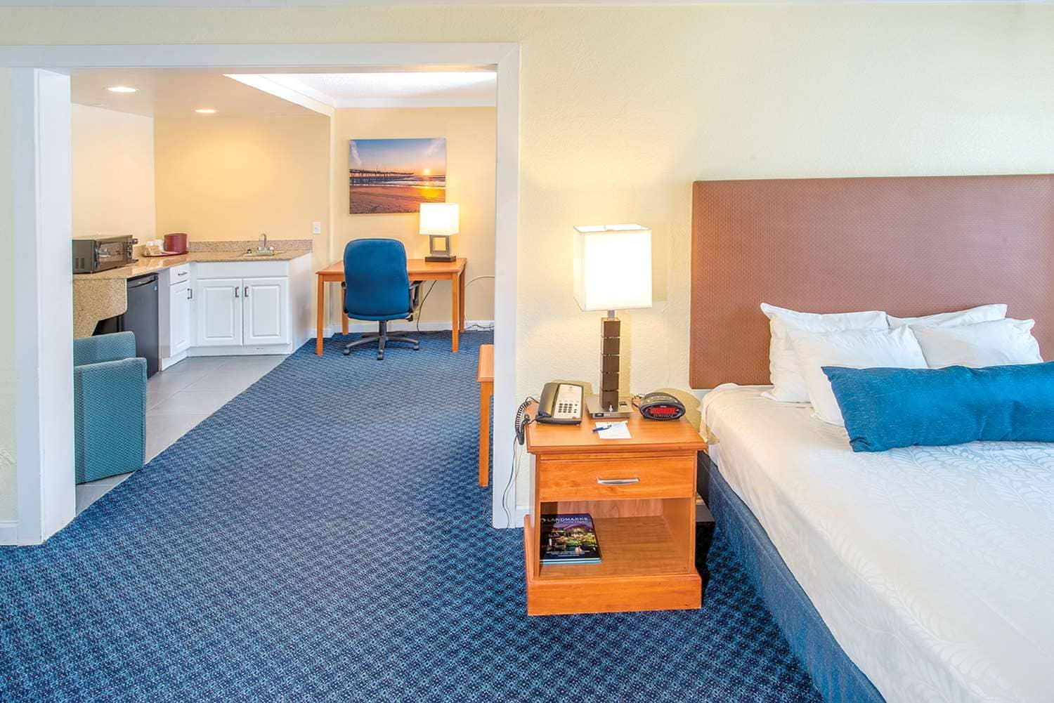 our parlor suites offer 1 queen bed and are located in our non oceanfront building located across the street from the main hotel - Cheap Hotels In Virginia Beach With Kitchenette